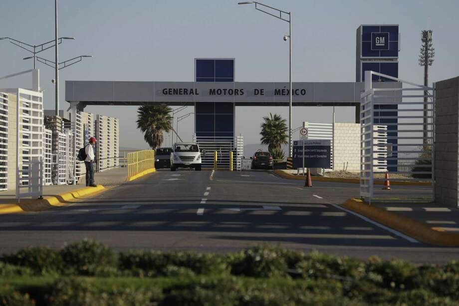 Cars exit the General Motors assembly plant in Villa de Reyes, outside San Luis Potosi, Mexico, where the Aveo and Trax vehicles have been produced since 2008. U.S. proposals to tax imports would boost the average cost of a car by about $3,300, sap demand and lead manufacturers to shrink their U.S. workforce, according to consultant Roland Berger. Because parts are sourced around the globe, all automotive companies would be affected. Photo: Rebecca Blackwell /Associated Press / Copyright 2017 The Associated Press. All rights reserved.