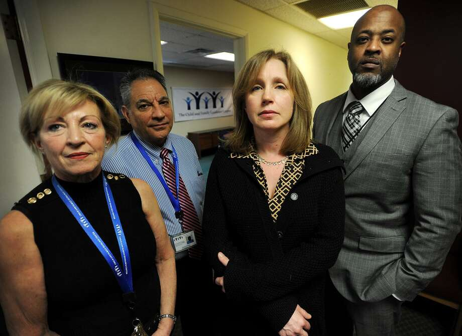 Ann McCarthy, second from right, and her co-workers from left; Irma Camacho, Michael Patota, and Terril Pile, at The Child & Family Guidance Center at 180 Fairfield Avenue in Bridgeport, Conn. on Wednesday, February 8, 2017. The center is a behavioral health outpatient facility for children and families and works with many undocumented city residents. McCarthy, a Fairfield resident photographed for the Connecticut Post at Monday's sanctuary city rally at Bridgeport City Hall, was used as an example by Mayor Joseph Ganim that suburban residents shouldn't involve themselves in city business. Photo: Brian A. Pounds / Hearst Connecticut Media / Connecticut Post