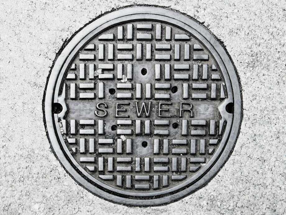 A manhole cover similar to this one was subjected to a sexual assault in Romford, England. Photo: Steven Puetzer, Getty Images