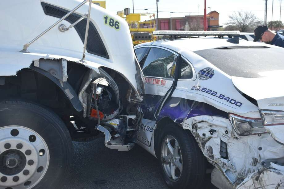 A S.E.A.L. Security patrol car carrying canine security for local H-E-B stores was involved in a wreck that closed parts of Interstate 35 on Wednesday, Feb. 8, 2017. Photo: Caleb Downs / San Antonio Express-News