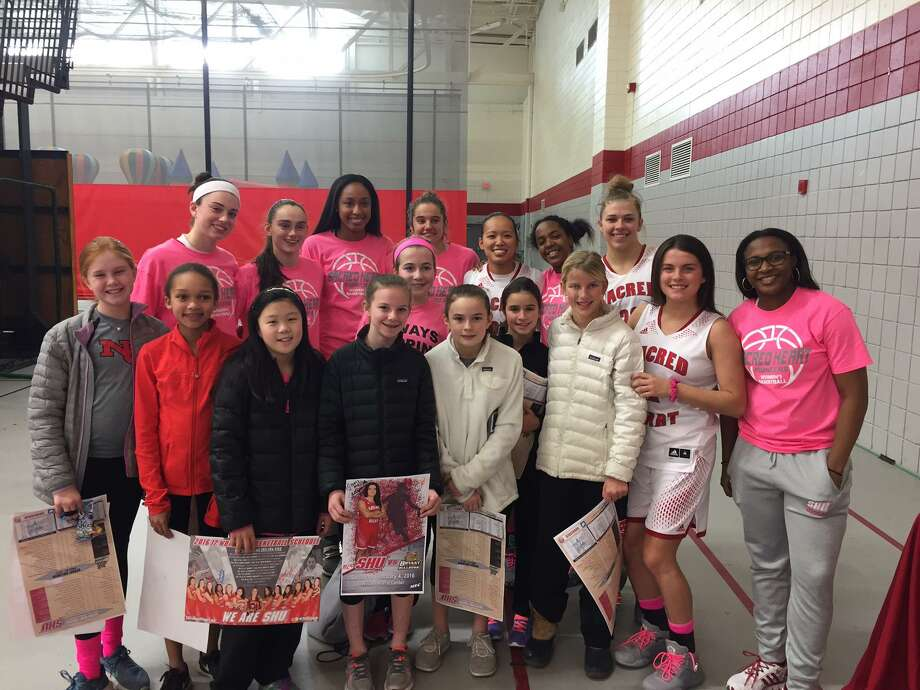 New Canaan Basketball Association's fifth grade girls Black team road-tripped to Fairfield to support the Sacred Heart women's basketball team battle the Bryant Bulldogs. Sacred Heart Head Coach Jessica Mannetti, a New Canaan High School graduate, is in her fourth year coaching the Pioneers. The Pioneers defeated the Bulldogs and are currently sitting in first place in their Northeast conference standings. NCBA fifth grade girls Black team is also having a successful season with Coach Tim O'Reilly. The team is currently 16-3 and in first place in the Fairfield County Basketball League Central division. Photo: Contributed Photo / New Canaan News contributed