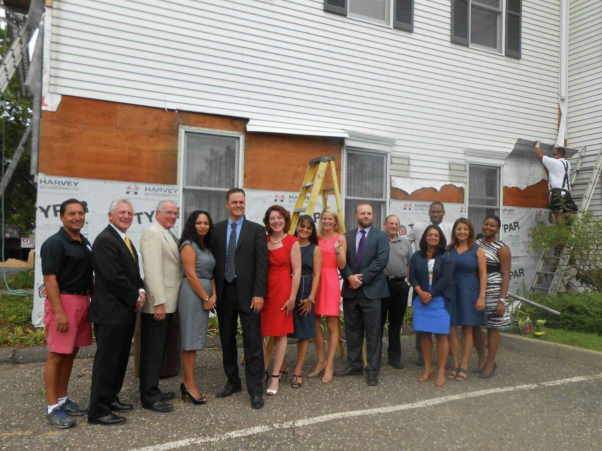Pictured from left to right: Jim DePasquale, Sound Renovation Roofing & Siding, Mayor Harry Rilling. Tom Dorsey, Eversource, Lisette Andino, Eversource, Anthony DiLauro, Human Services Council, Maureen Hanley, Kim Karl and Kate Eren, Mark Hubina all from United Bank, Lou Schulman, Human Services Council, Steven Ferguson, First County Bank/Human Services Council, Giovanna Pisani, Ingrid Pasten and Krystal Maxwell, all of the Human Services Council.
