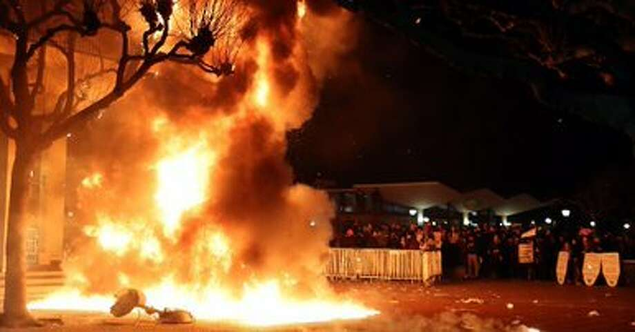 Anarchists set fire to a police generator at UC Berkeley's Sproul Plaza to protest plans for a speech by right-wing agitator Milo Yiannopoulos on Feb. 1. Photo: Nanette Asimov