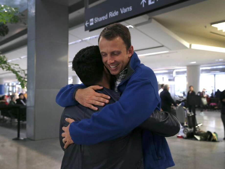 Matthew Ball embraces Afghan interpreter Qismat Amin after Amin cleared customs at SFO in San Francisco, Calif. on Wednesday, Feb. 8, 2017. Amin's arrival ends a long effort by Amin and Matthew Ball, the Army captain he translated for during Ball's deployment in Afghanistan, to gain permanent U.S. residence. Photo: Paul Chinn, The Chronicle