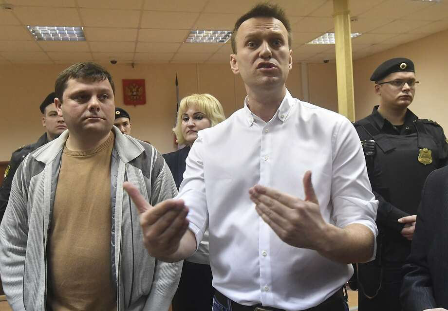 Opposition leader Alexei Navalny (center) was found guilty in the retrial of a 2013 fraud case, which disqualifies him as a candidate for president next year. He vowed to keep campaigning. Photo: Sergei Bonurin, Associated Press