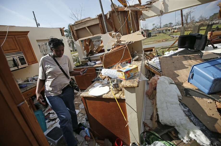 Carla Wilson walks through the former kitchen of her mother's home in the aftermath of a tornado that tore through a neighborhood in the eastern section of New Orleans. Photo: Gerald Herbert, Associated Press