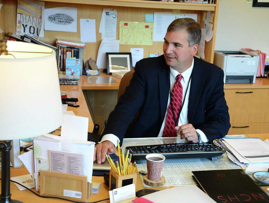 Principal Bryan Luizzi works in his office Monday, June 23, 2014, at New Canaan High School. Photo: Nelson Oliveira / Nelson Oliveira / New Canaan News