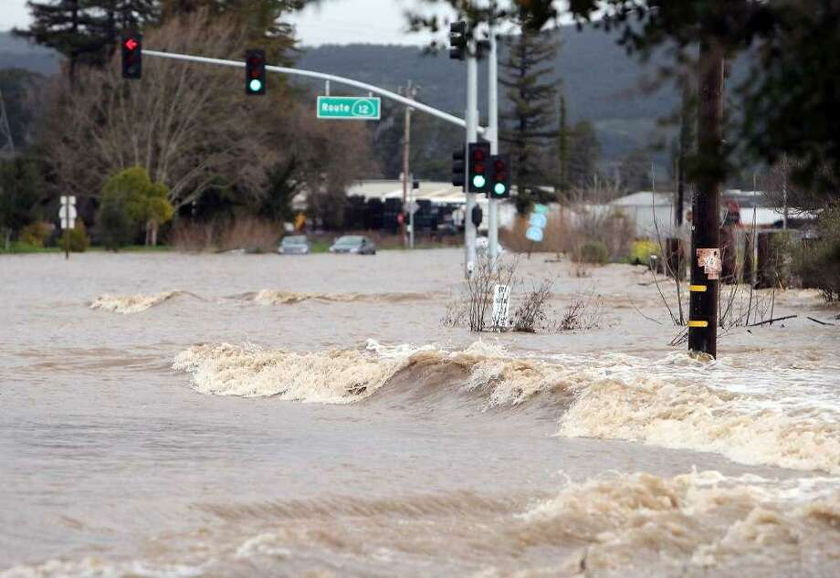 The intersection of Highway 12 and Highway 121 is overrun with floodwaters in Sonoma, Calif., on Tuesday, February 7, 2017. Photo: Scott Strazzante, The Chronicle / Scott Strazzante, The Chronicle