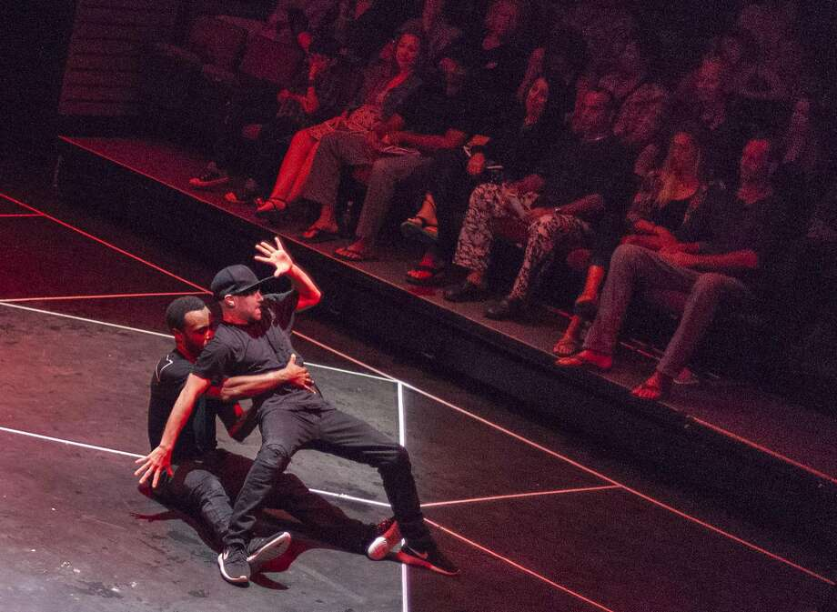 """Opposing Forces"" features B-boy dancers MozesLateef (seated) and Fever One, shown performing in Hawaii. Photo: Courtesy Of Maui Cultural Center"