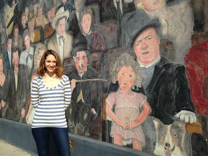 """Elizabeth Schmidt stands next to the """"You Are the Star"""" mural in Hollywood, outside of Seb's """"day job"""" bar. (The interior of the """"La La Land"""" bar is actually The Smoke House, a restaurant four miles away in Burbank.  Photo by Robert Spuhler"""