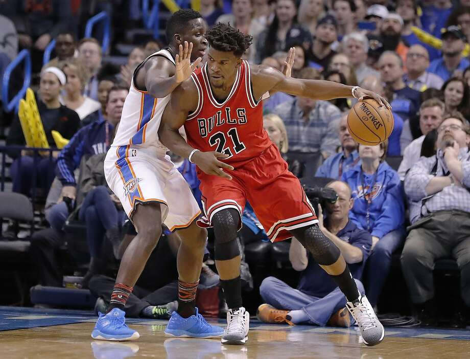 Chicago Bulls forward Jimmy Butler (21) drives to the basket as Oklahoma City Thunder guard Victor Oladipo (5) defends during the first half of an NBA basketball game in Oklahoma City, Wednesday, Feb. 1, 2017. (AP Photo/Alonzo Adams) Photo: Alonzo Adams, Associated Press