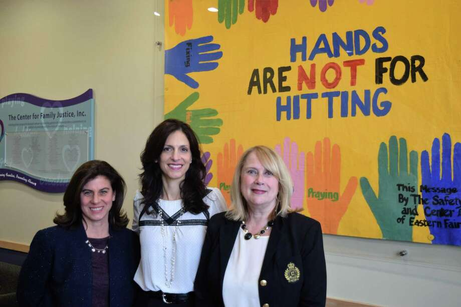 From left, Jennifer Ferrante, Angela Schlingheyde and Debra Greenwood in the lobby of the Center for Family Justice in Bridgeport. Photo: FCBJ / Fairfield County Business Journal