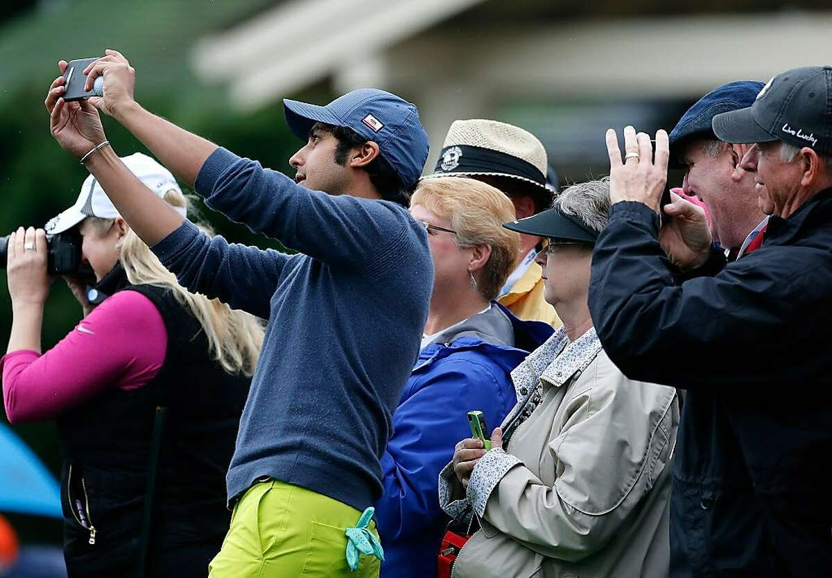 PEBBLE BEACH, CA - FEBRUARY 08: Actor Kunal Nayyar takes a selfie with fans in the 3M Celebrity Challenge during a practice round for the AT&T Pebble Beach National Pro-Am at Pebble Beach Golf Links on February 8, 2017 in Pebble Beach, California. (Photo by Jonathan Ferrey/Getty Images)