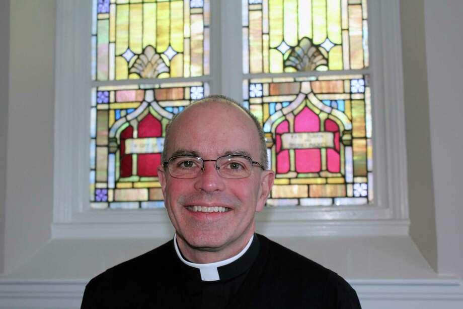 Rev. Robert Kinnally at St. Aloysius Church in New Canaan on Jan. 30. Photo: Justin Papp / Hearst Connecticut Media / New Canaan News