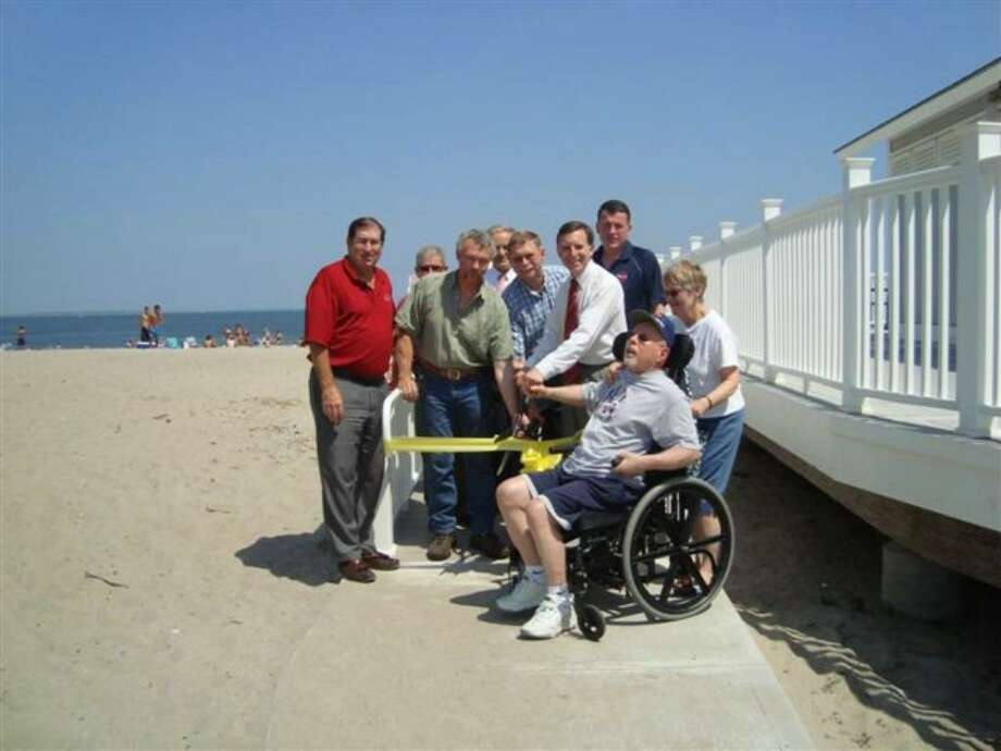 The Fairfield Parks and Recreation Department unveiled an Americans with Disability Act (ADA) accessible ramp at the newly renovated east wing of the Penfield Pavilion. Gathered Wednesday at the beach are, from left, Gerry Lombardo, Parks and Recreation Department director; Steve Lehning, working foreman; Ken Flatto, First Selectman; Buzz and Mary Helen Veronesi, Fairfield residents; Ed McCourt, building maintenance supervisor; Richard White, director of Public Works; Alan Moisio, draftsman engineering aide; and Jack Tetreau, Parks and Recreation Commission member. Photo: Contributed Photo / Fairfield Citizen