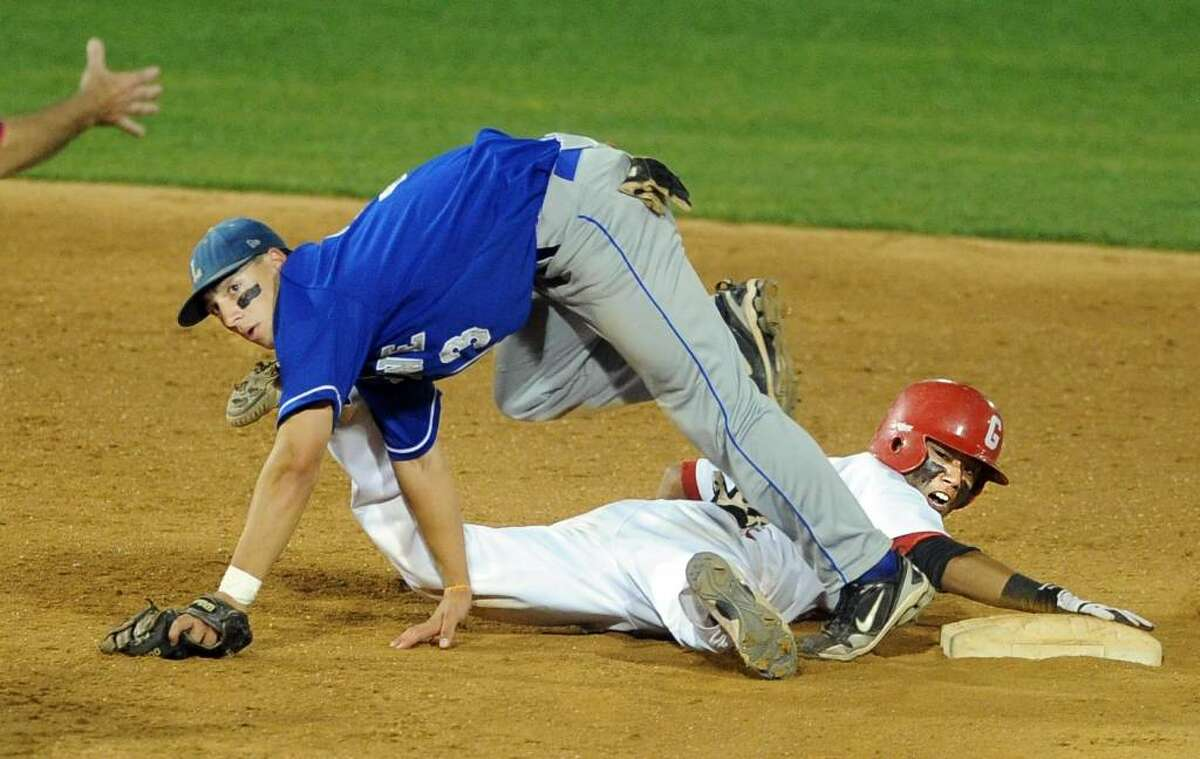 Fairfield Ludlowe's Nick Rossomando and Greenwich's Yuta Okazaki look for the call during the FCIAC Baseball Championship game Thursday May 27, 2010 at the Ballpark at Harbor Yard in Bridgeport. Okazaki was out at second base.