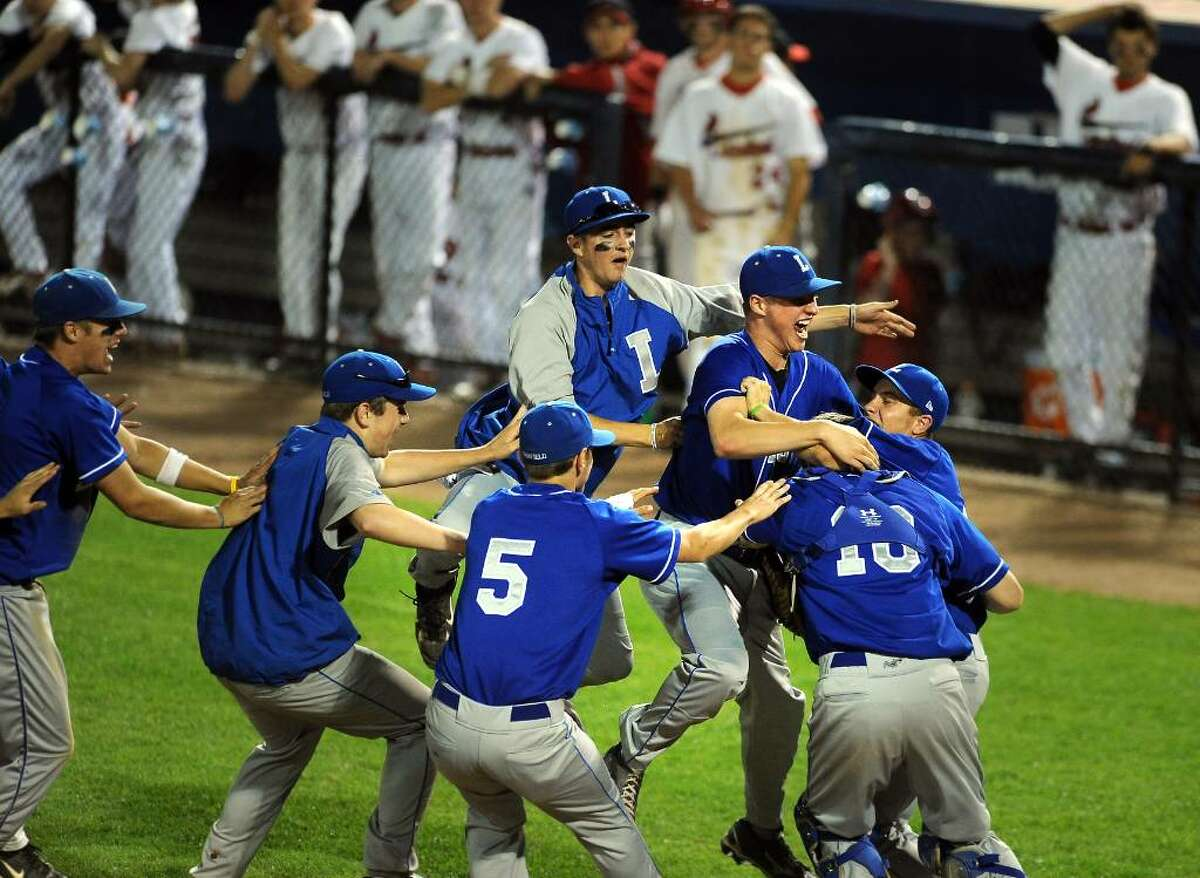 Fairfield Ludlowe celebrates their win over Greenwich in the FCIAC Baseball Championship game Thursday May 27, 2010 at the Ballpark at Harbor Yard in Bridgeport.
