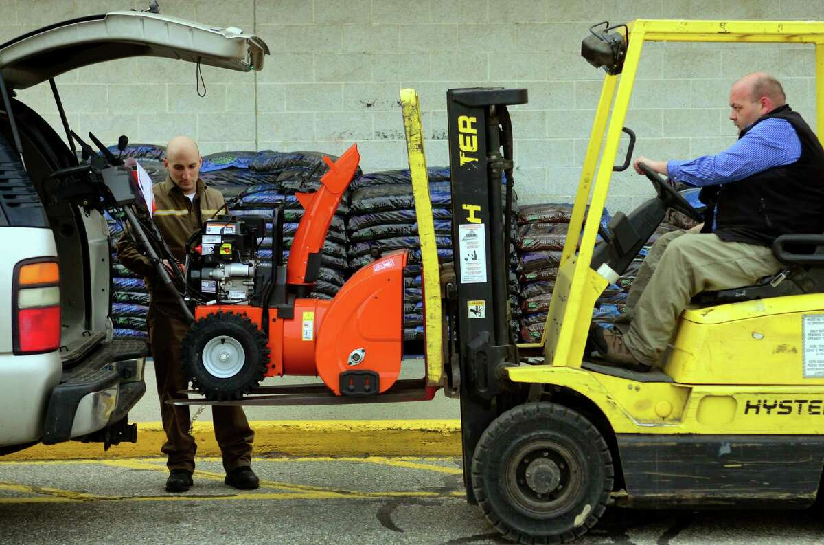 Sears employee Ralph Clark uses a forklift to place a snowblower into a truck for customer Alfredo Fontana, of Trumbull, at Sears Appliance and Hardware store in Shelton, Conn., on Wednesday Feb. 8, 2017. Weather forecasts predict 6 to 12 inches of snow for Thursday.