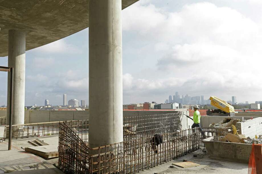 Work proceeds last week on the Kirby Collection. The project includes a 25-story residential tower. Photo: Melissa Phillip, Staff / © 2017 Houston Chronicle