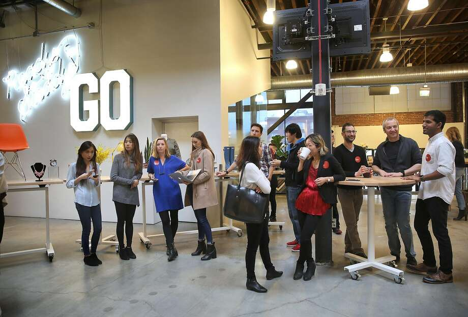 Pinterest employees line up in San Francisco in February before the company announced new products. Photo: Liz Hafalia, The Chronicle