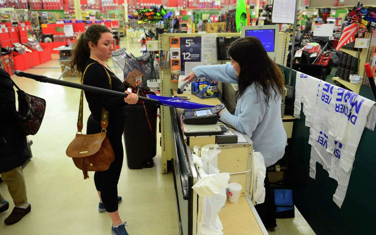 Sacred Heart University student Samantha Burke buys a snow sheovel at the last minute at the Sears Appliance and Hardware store in Shelton, Conn., on Wednesday Feb. 8, 2017. Weather forecasts are predicting 6 to 12 inches of snow for Thursday.