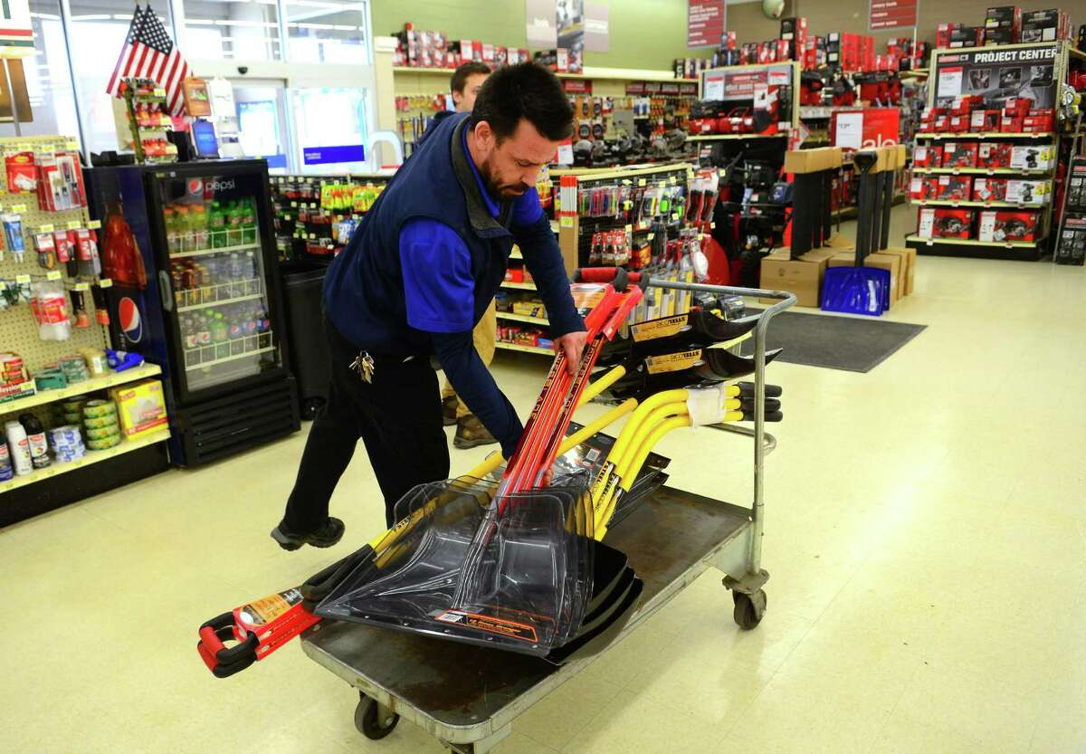 General Manager Steven Crook puts out a fresh stock of snow shovels for customers at Sears Appliance and Hardware store in Shelton, Conn., on Wednesday Feb. 8, 2017. Weather forecasts predict 6 to 12 inches of snow for Thursday.