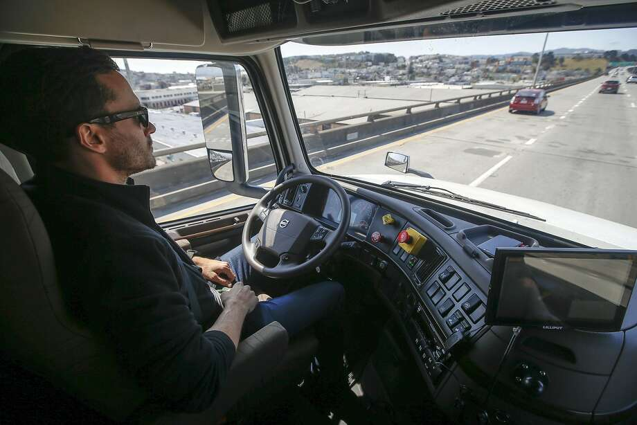 Matt Grigsby, senior program engineer at Otto, takes his hands off the steering wheel of a self-driving, big-rig truck during a demonstration in August on the highway in the Bay Area. Photo: Tony Avelar, Associated Press