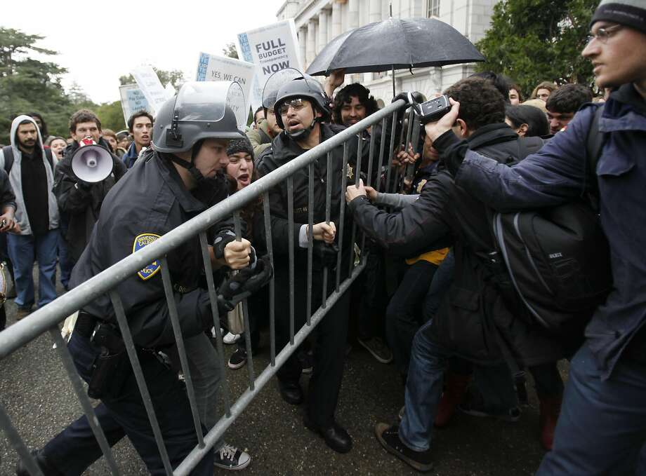 Demonstrators struggle with police during a protest at UC Berkeley in 2009. During this month's protest, police took more of a hands-off approach. Photo: Paul Sakuma, AP