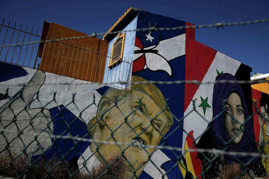 A mural of President Donald Trump on the side of a home in Tijuana, Mexico. Photo: Justin Sullivan, Getty Images / 2017 Getty Images