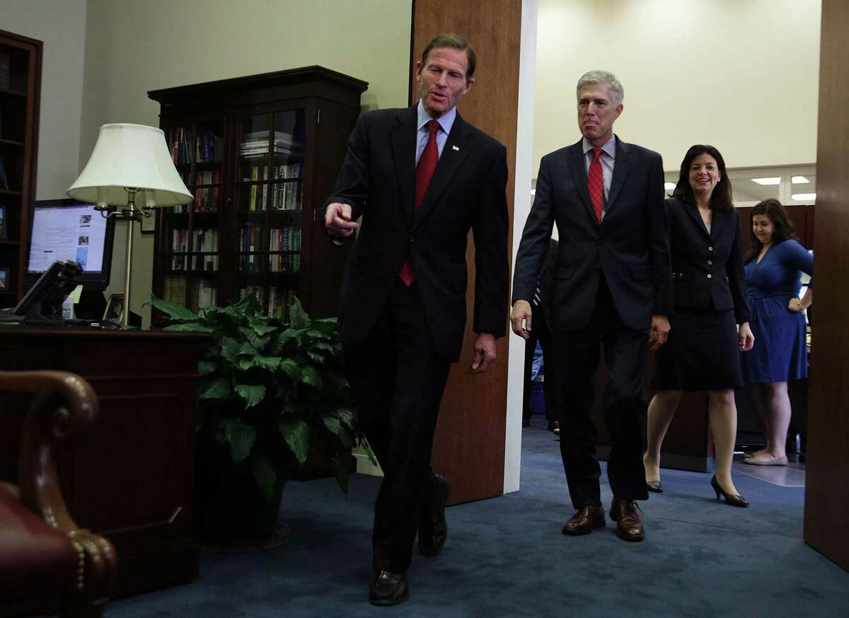 U.S. Supreme Court nominee Judge Neil Gorsuch (2nd L) arrives with former Sen. Kelly Ayotte (R-NH) (R) at the office of Sen. Richard Blumenthal (D-CT) (L) for a meeting February 8, 2017 in Washington, DC. Gorsuch continued his visits with senators from both parties.