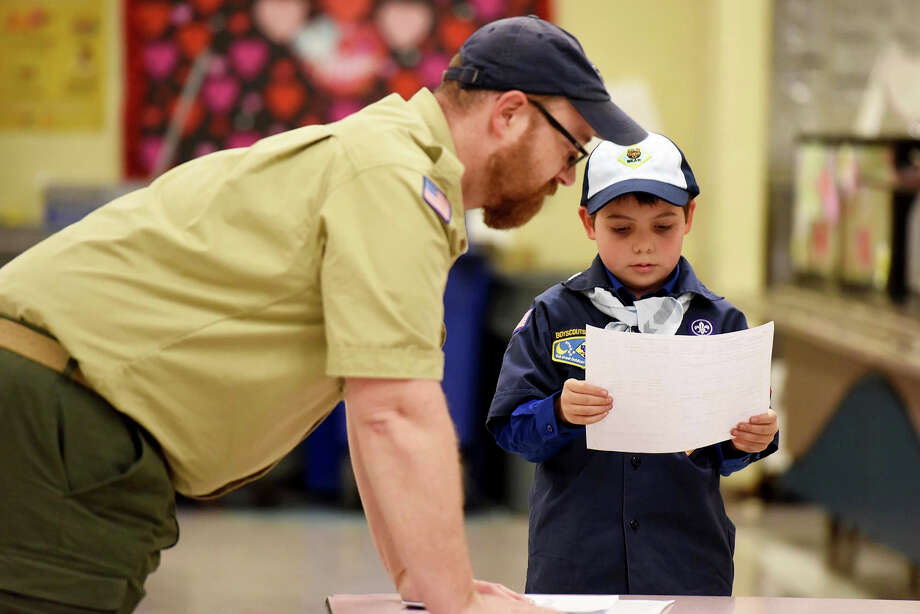 "Scout leader Kyle Hackler and Joe Maldonado, the first openly transgender member of the Boy Scouts, look over the boy's to Pack 87 in Maplewood, N.J. ""This is so fun; I'm so proud,"" the 9-year-old boy said. Photo: Amy Newman, MBR / 2017 North Jersey Media Group"