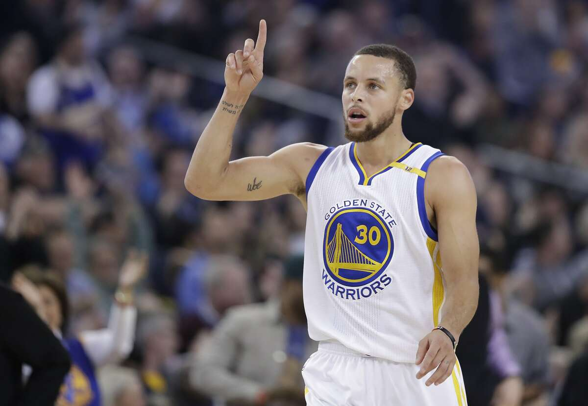 Golden State Warriors' Stephen Curry (30) celebrates after scoring against the Charlotte Hornets during the first half of an NBA basketball game Wednesday, Feb. 1, 2017, in Oakland, Calif. (AP Photo/Marcio Jose Sanchez)