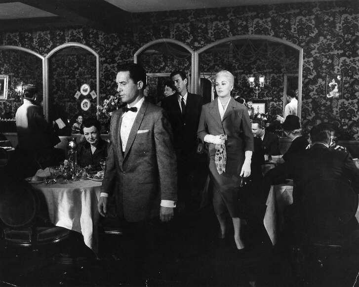 "Actress Kim Novak walks through Ernie's Restaurant on Montgomery Street in San Francisco, Calif., in the 1957 movie ""Vertigo."""