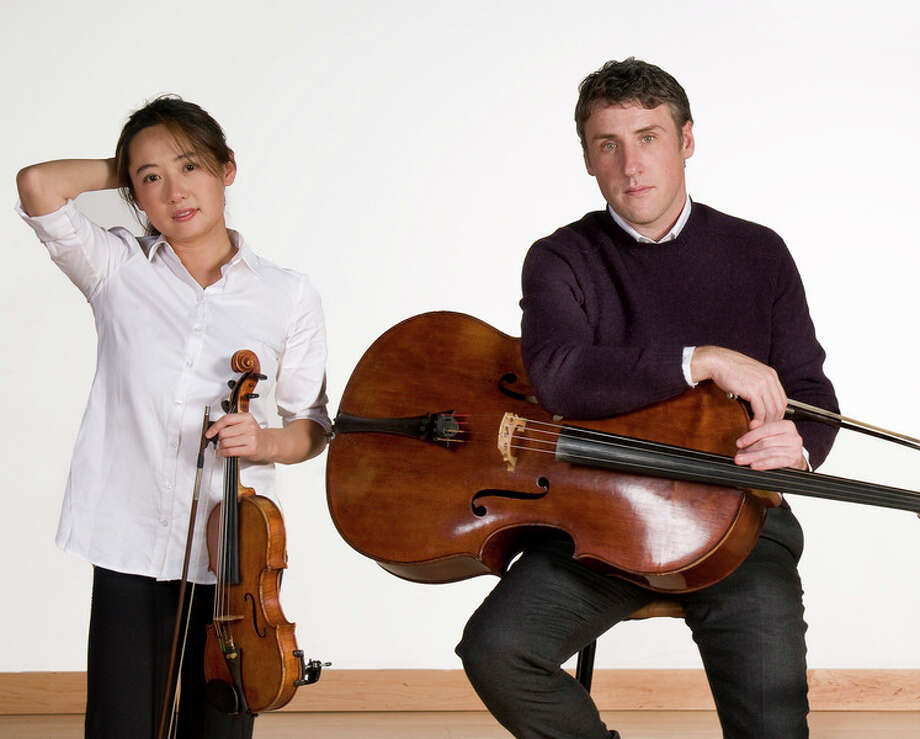 Photo provided Cellist Patrick Owen, right, returns to Midland to perform with the Midland Symphony Orchestra. He will perform with his colleague, violinist Amanda Wang, at left.