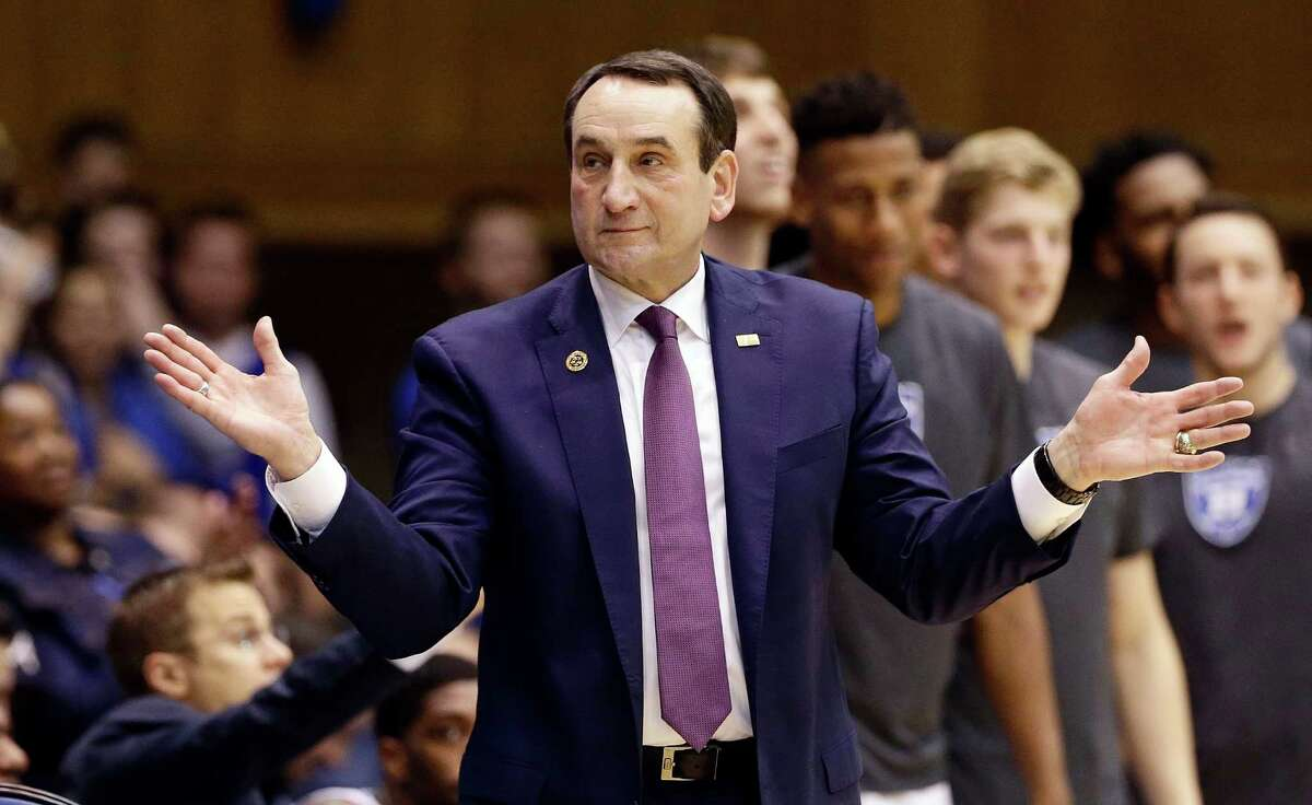 FILE - In this Nov. 29, 2016, file photo,Duke coach Mike Krzyzewski reacts during the second half of an NCAA college basketball game against Michigan State in Durham, N.C. Krzyzewski says he is returning this weekend to coach his Duke Blue Devils. The Hall of Fame coach made the announcement Thursday, Feb. 2, 2017, on his weekly radio show that he will make his return Saturday against Pittsburgh after back surgery kept him out for four weeks.(AP Photo/Gerry Broome, File) ORG XMIT: NY903