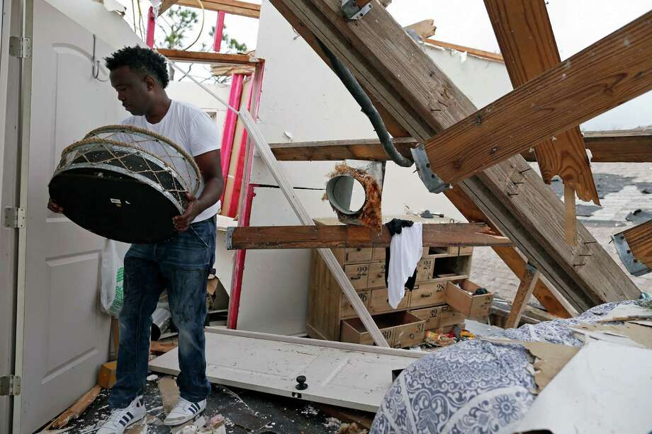 Dwight Powell recovers mirrors from the bathroom of his master bedroom a day after a tornado touched down in eastern New Orleans, Wednesday, Feb. 8, 2017. (AP Photo/Max Becherer) Photo: Max Becherer, FRE / Max Becherer