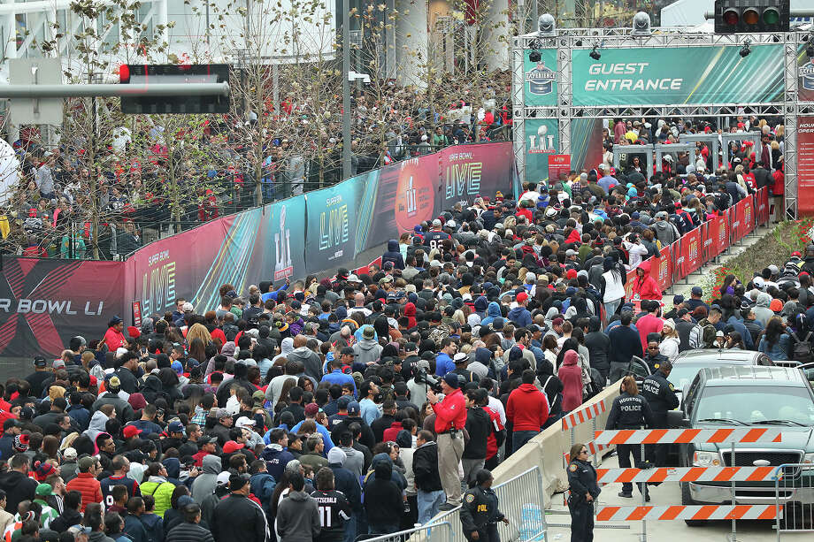Thousands of fans wait in line to get into the NFL Experience and Super Bowl Live the evening before the Super Bowl on Saturday Feb. 4, 2017, in Houston. (Curtis Compton/Atlanta Journal-Constitution/TNS) Photo: Curtis Compton, MBR / Atlanta Journal-Constitution