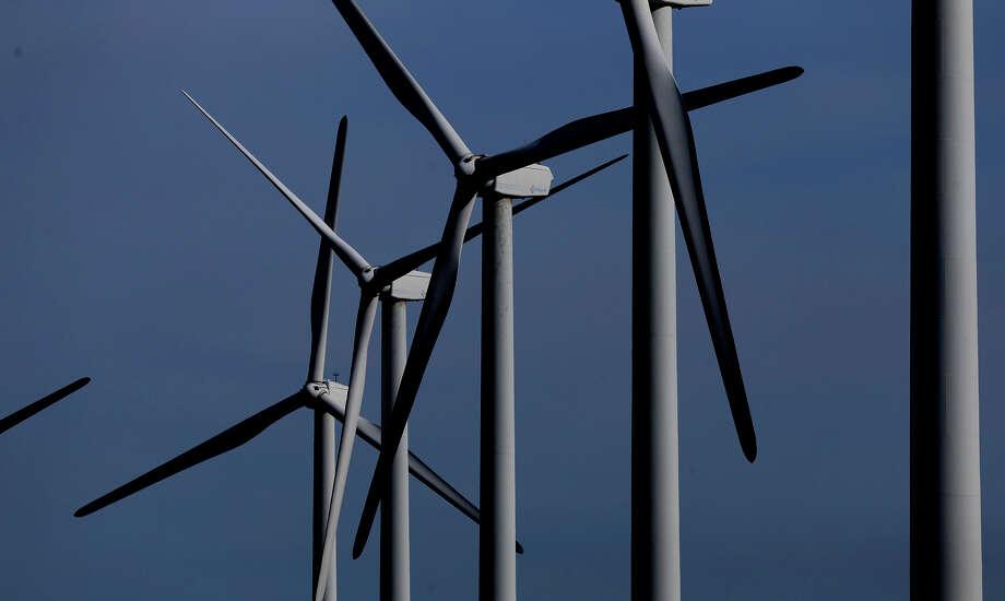 Desert Sky Wind Farm turbines twirl in the January 2017 wind near Iraan, Texas. The power generated goes to San Antonio. (John Davenport / San Antonio Express-News) Photo: John Davenport, Staff / ©San Antonio Express-News/John Davenport