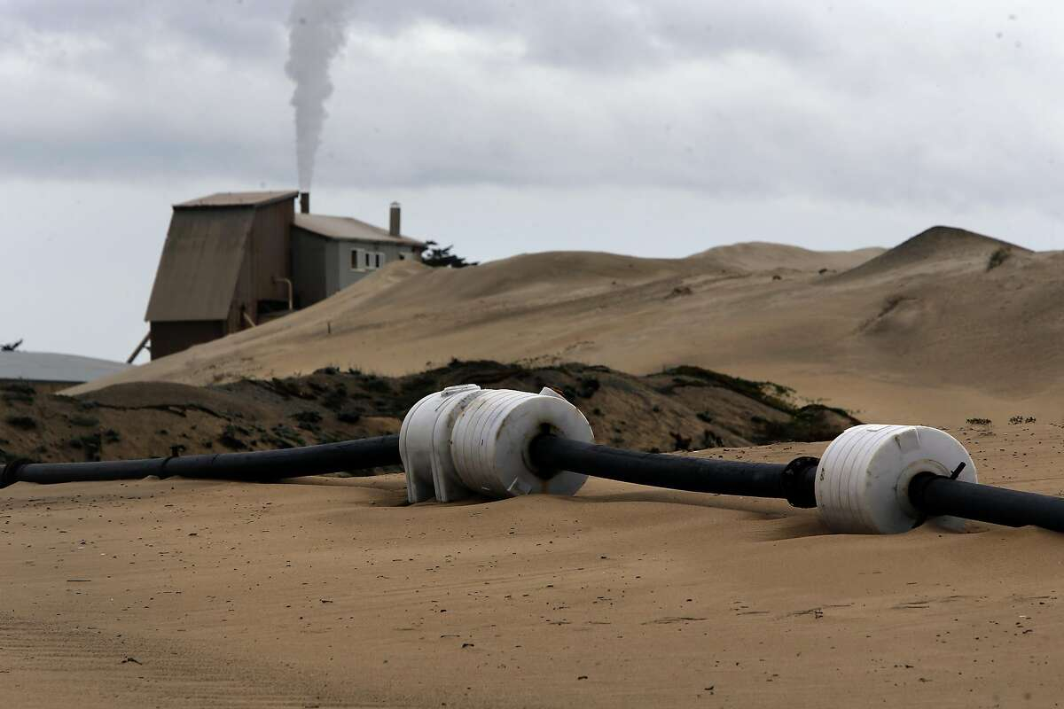 A quarter mile of pipes transport the sand collected by a dredge owned by Cemex to the processing facility along the Monterey Bay coastline in Marina, Ca., as seen on Wednesday Feb. 8, 2017. The Lapis Plant removes more than 200,000 acre feet of beach sand a year.