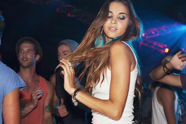 Woman dancing on dance floor in nightclub