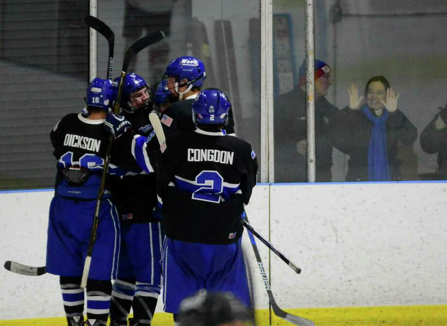 Darien celebrates a goal against Fairfield Prep during boys hockey action at the Wonderland of Ice in Bridgeport, Conn., on Wednesday Feb. 8, 2017. Photo: Christian Abraham / Hearst Connecticut Media / Connecticut Post