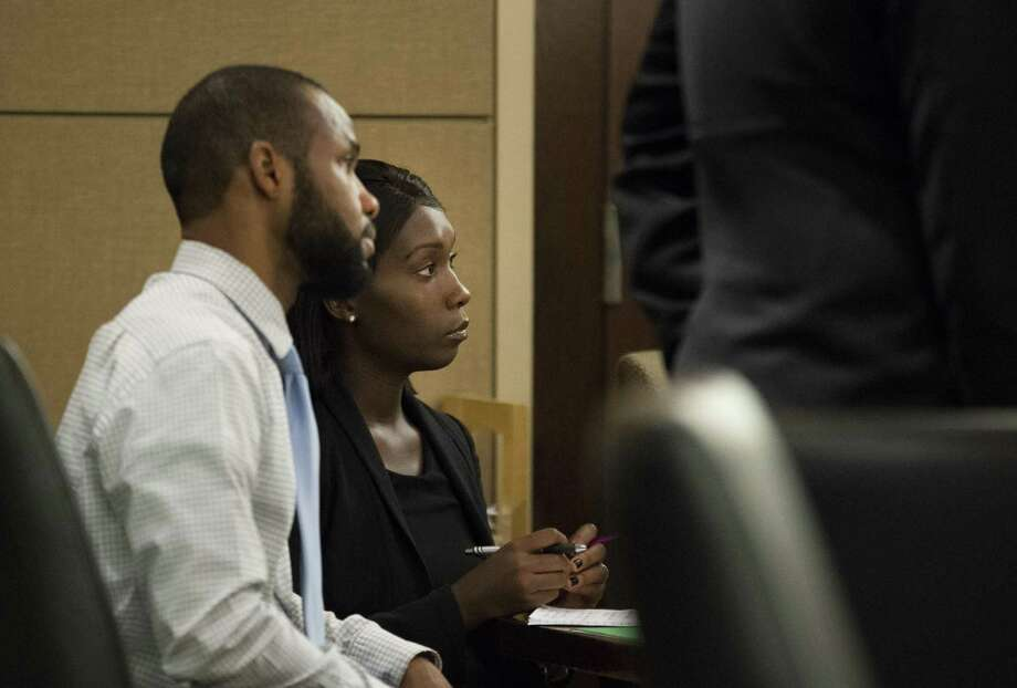 Marquita Johnson, right, and Qwalion Busby sit during their trial on Wednesday, Feb. 8, 2017, in the 290th State District Court in San Antonio. Johnson and Busby are charged with injury to a child, accused of withholding traditional medical treatment from their son, who later died as a result of illness. (Darren Abate/For the San Antonio Express-News) Photo: Darren Abate, FRE / San Antonio Express-News / San Antonio Express-News