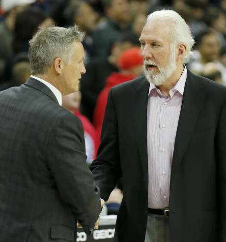 Philadelphia 76ers head coach Brett Brown, left, meets with San Antonio Spurs head coach Gregg Popovich after the Spurs' 111-103 win on Wednesday, Feb. 8, 2017, at the Wells Fargo Center in Philadelphia. (Yong Kim/Philadelphia Daily News/TNS) Photo: YONG KIM/TNS