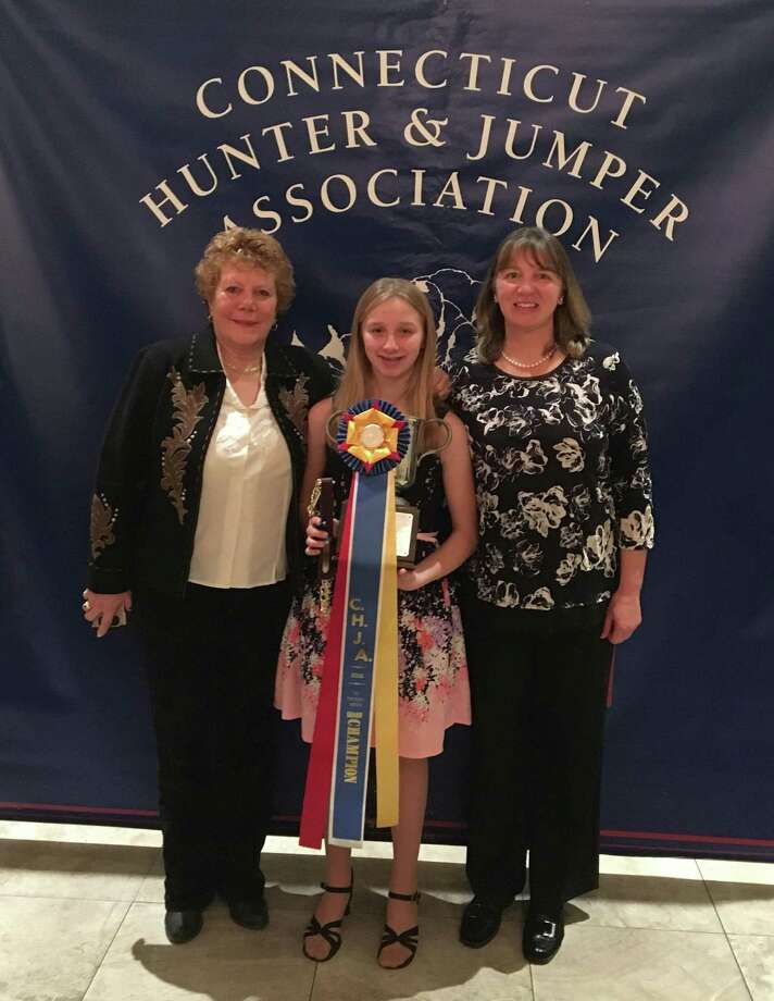 The Connecticut Hunter & Jumper Association in Connecticut recently held its 47th annual awards banquet in at the Aqua Turf Club. Devon LeMoine of Roxbury won the Year End Champion Award of the Pre-Children's Hunter Division with IT Must Be Magic owned by Sue Peterson of Bethlehem. Devon rides at Cavalier Farm with Cheryl LeMoine in New Milford. Photo: Courtesy Of Cavalier Farm / The News-Times Contributed
