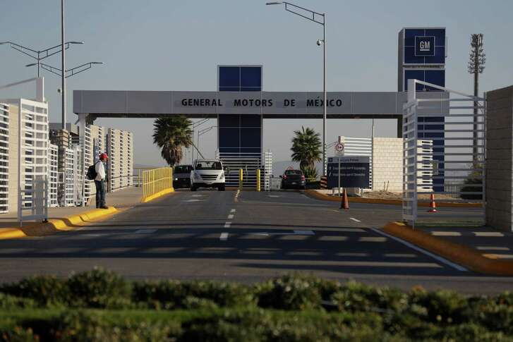 FILE - In this Wednesday, Jan. 4, 2017, file photo, cars exit the General Motors assembly plant in Villa de Reyes, outside San Luis Potosi, Mexico, where the Aveo and Trax vehicles have been produced since 2008. Some of America's most popular cars and trucks are made in Mexico, for now. Many American car buyers have benefited from Mexico's emergence as a production hub. But Mexico's growing share of the auto market is a sore spot for President Donald Trump, who has threatened to impose border taxes on Mexican imports to force companies to make cars in the U.S. (AP Photo/Rebecca Blackwell, File)