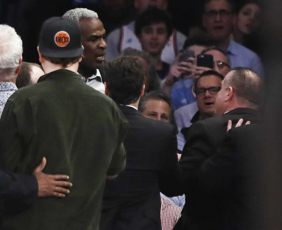 Former New York Knicks player Charles Oakley exchanges words with a security guard during the first half of an NBA basketball game between the New York Knicks and the LA Clippers, Wednesday, Feb. 8, 2017, in New York. (AP Photo/Frank Franklin II) Photo: Frank Franklin II, Associated Press