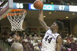 Texas A&M forward Robert Williams (44) dunks over Missouri guard Cullen VanLeer (33) during an NCAA college basketball game Wednesday, Feb. 8, 2017, in College Station, Texas. (Timothy Hurst/College Station Eagle via AP)