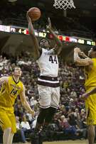 Texas A&M freshman forward Robert Williams (44) puts a shot up past Missouri defenders during an NCAA college basketball game Wednesday, Feb. 8, 2017, in College Station, Texas. (Timothy Hurst/College Station Eagle via AP)