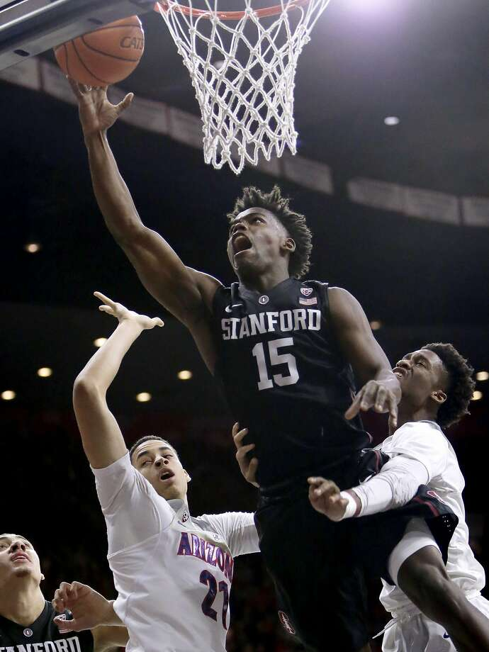 Stanford's Marcus Allen drives between Ariz ona's Chance Comanche and Kobi Simmons. Photo: Rick Scuteri, Associated Press