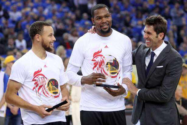Golden State Warriors' Bob Myers with January co-players of the month, Kevin Durant and Stephen Curry, before 123-92 win over Chicago Bulls in NBA game at Oracle Arena in Oakland, Calif., on Wednesday, February 8, 2017.